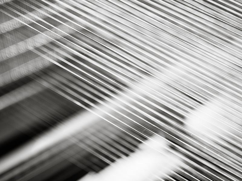 Photo de fils qui s'entrecroisent pour créer une percale de coton